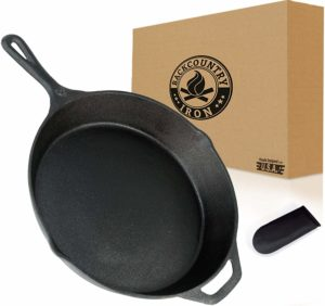 The Backcountry Cast Iron Skillet is pictured over a field of white