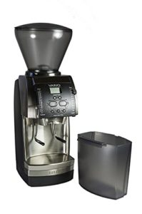 The Baratza Vario Flat Burr Coffee Grinder is pictured over a field of white