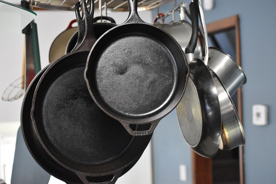 Cast iron skillets handing in a kitchen