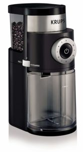 The KRUPS GX5000 Burr Coffee Grinder is pictured over a field of white