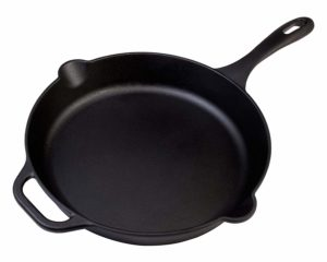 The Victoria 12 Inch Cast Iron Skillet is pictured over a field of white